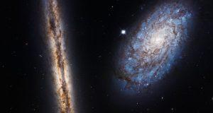 Хаббл отпраздновал свою 27-ю годовщину запечатлев пару галактик